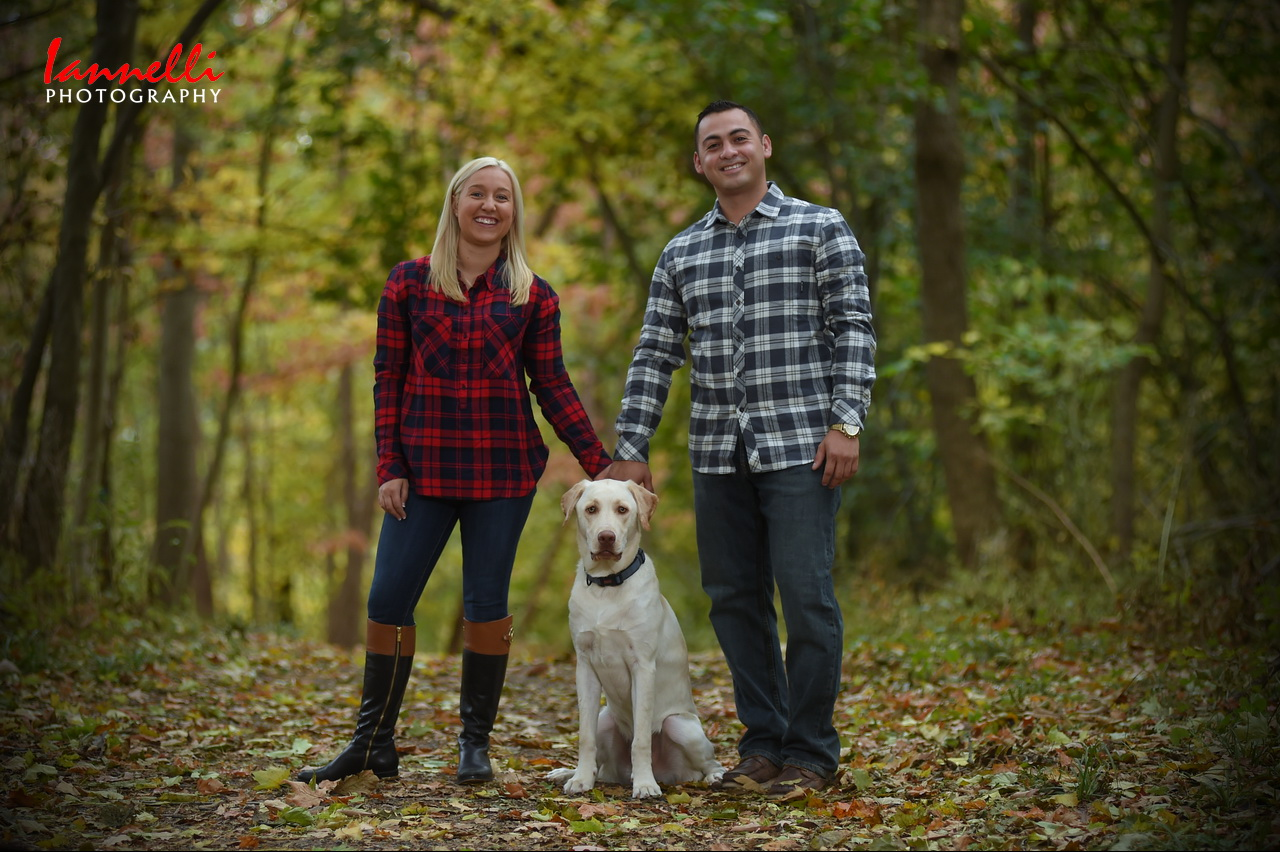 Couple Standing with Dog