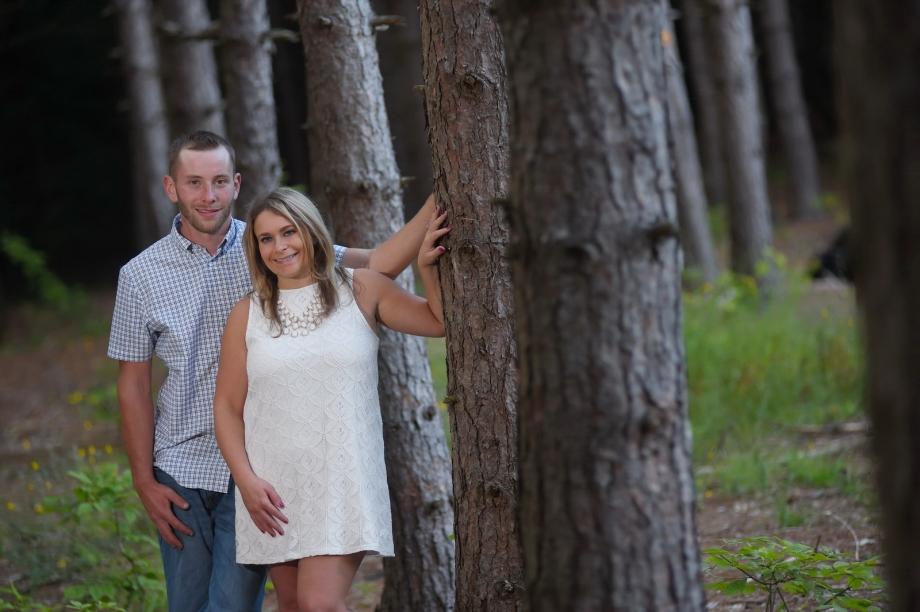 Couple looking around Tree